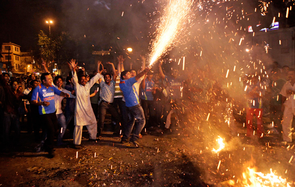 Indian cricket fans celebrate their team's victory over Sri Lanka to win the Cricket World Cup final, in New Delhi, India. (AP)