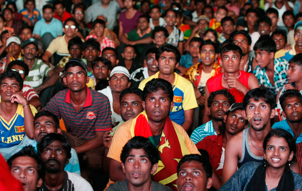 Sri Lankan cricket fans react as they watch India closing in to beat Sri Lanka in the Cricket World Cup final match, in Colombo, Sri Lanka. (AP)