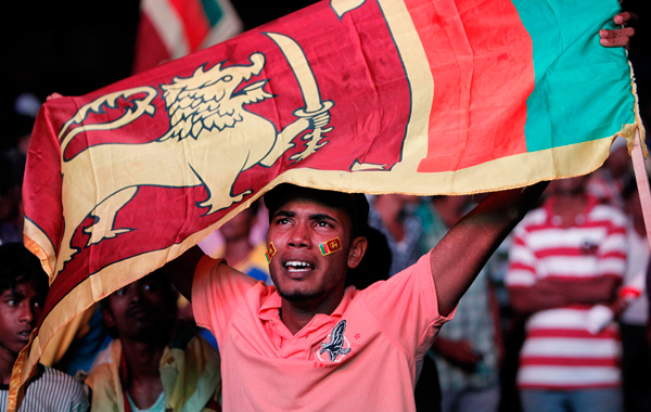 A Sri Lankan cricket fan reacts after his team lost the World Cup Cricket finals to India, in Colombo, Sri Lanka. (AP)