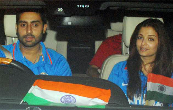 Abhishek and Aishwarya celebrate and cheer for India on the road after the big win.
