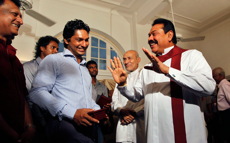 Sri Lankan President Mahinda Rajapaksa, right, talks to Kumar Sangakkara during a meeting with Sri Lankan cricketers at his residence in Colombo, Sri Lanka, Monday, April 4, 2011. The runners up arrived home on Sunday and boarded an open bus for a welcome ceremony. India beat Sri Lanka by six wickets in Saturday's World Cup final (AP)