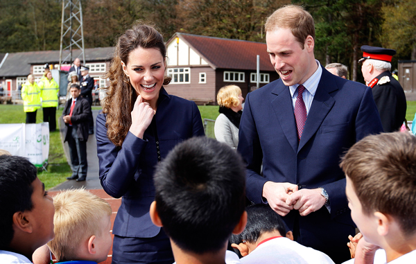 Kate Middleton and Prince William talk with youngsters from a local soccer club at Witton County Park, during a visit Darwen Aldridge Community Academy. (GETTY)