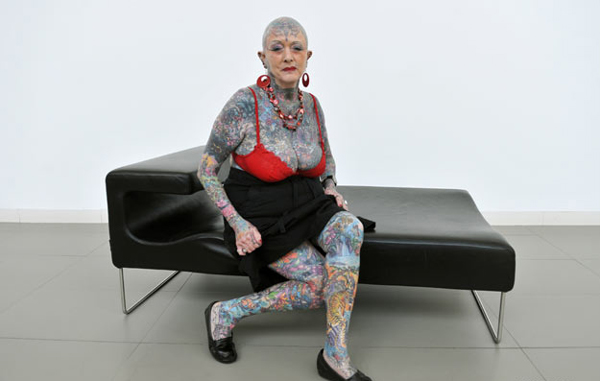 Most senior tattooed woman: Septuagenarian Isobel Varley poses during 'II Expotatoo' tattoo fair in Gijon, northern Spain, May 15, 2009. Varley, who was born in 1937, is the most senior tattooed woman in the world according to the Guinness World Records. (REUTERS)