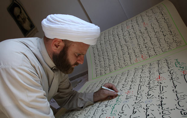 Largest handwritten Koran: Lebanese Shi'ite sheikh Hassan al-Zayyat marks punctuation on Koranic verses that he had hand copied on 100x70 cm (39x28 inch) pages in his village of Tayr Dibba, southern Lebanon, August 30, 2010, aspiring to enter the Guinness Book of World Records for the largest handwritten Koran. (REUTERS)