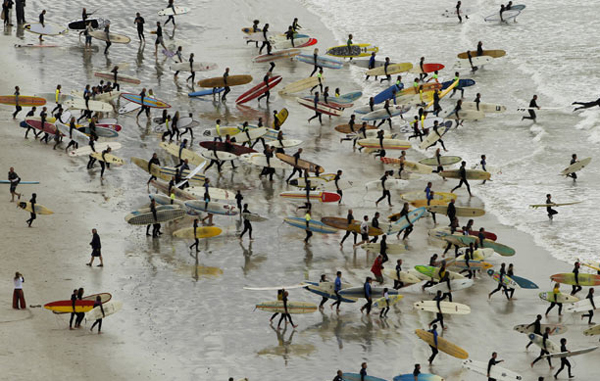 Highest number of riders on a single wave: South African surfers take to the water in an attempt to break the Guinness World Record for the highest number of riders on a single wave at Muizenberg in Cape Town, September 26, 2010. (REUTERS)