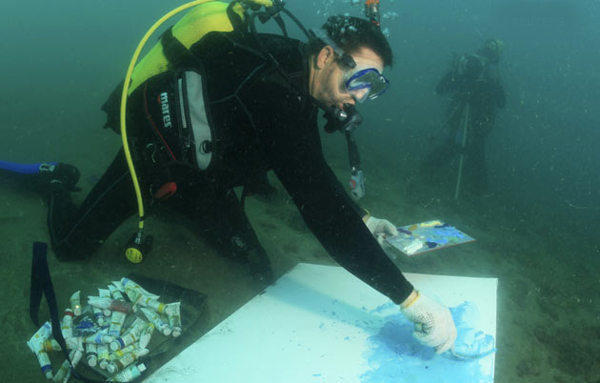Largest underwater painting: Alexandr Belozor paints on the bottom of the Black Sea near Yalta, during an attempt to create the largest underwater painting August 5, 2010. Belozor, 47, successfully created a 70 by 100 centimetres painting underwater while witnessed by a representative from Ukraine's national book of records. (REUTERS)