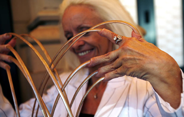 Longest fingernails: Lee Redmond, who holds the record for the woman with the longest fingernails, shows her nails during Ripley's Believe It Or Not! Odditorium grand opening in Times Square in New York June 21, 2007. (REUTERS)
