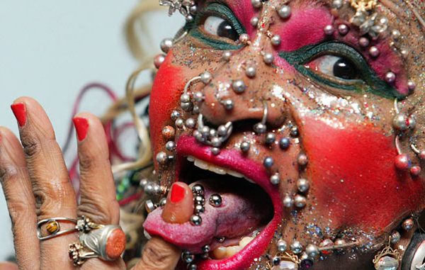 Greatest number of body piercings: Brazilian Elaine Davidson, who holds the Guinness world record for being the woman with the greatest number of body piercings - 1903 altogether - pokes her finger through her tongue at the Tate Modern art gallery in London, November 11, 2003. (REUTERS)