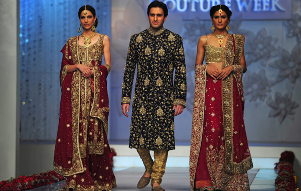 Models present creations by Pakistani designer Mehdi on the last day of Bridal Couture Week in Karachi. (AFP)
