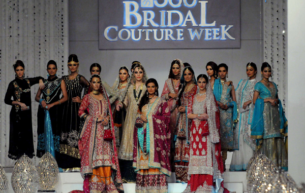 Models present  creations by Pakistani designer Mona Imran on the 2nd  day of Bridal Couture Week in Karachi. (AFP)