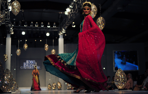 A model presents a creation by Pakistani designer Zainab Sajid on the 2nd  day of Bridal Couture Week in Karachi. (AFP)