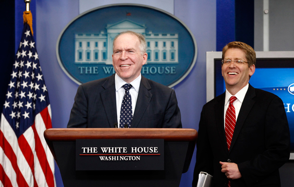 John Brennan (L), assistant to the president for homeland security and counterterrorism, and White House Press Secretary Jay Carney smile as they take the rostrum to speak about the killing of Osama bin Laden from the Briefing Room of the White House in Washington. (REUTERS)
