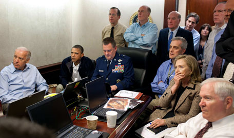 In this image released by the White House and digitally altered by the source to diffuse the paper in front of Secretary of State Hillary Rodham Clinton, President Barack Obama and Vice President Joe Biden, along with with members of the national security team, receive an update on the mission against Osama bin Laden in the Situation Room of the White House, Sunday, May 1, 2011, in Washington. (AP)