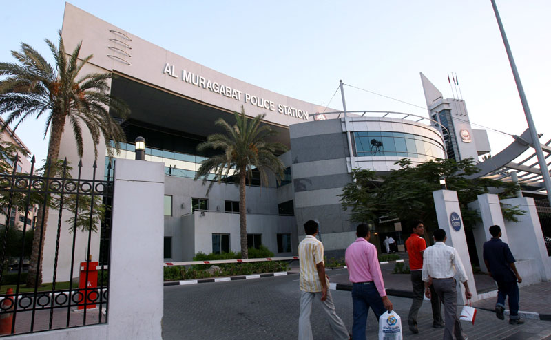 Pedestrians walk by Al Muraqabat Police Station in Dubai. (FILE)