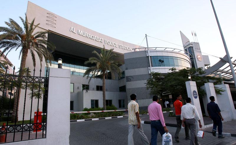 Pedestrians walk by Al Muraqabat Police Station in Dubai. (FILE)