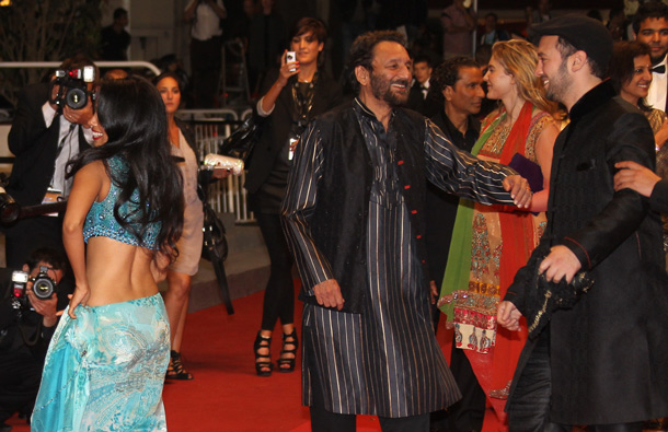 "Indian actor Shekhar Kapur (C) and US director Jeff Zimbalist (R) arrive on the red carpet before the screening of ""Bollywood - The Greatest Love Story Ever Told"" presented out-of-cometition at the 64th Cannes Film Festival on May 14, 2011. (AFP)"