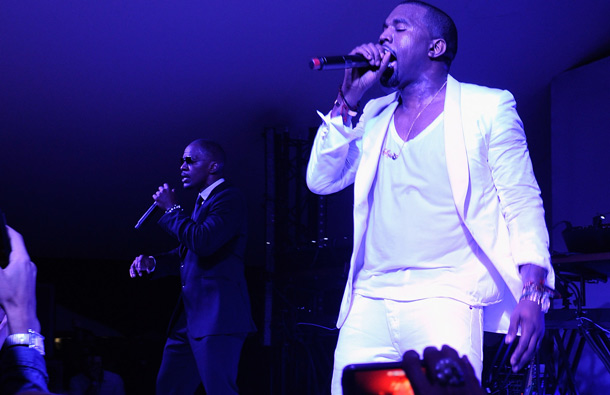 (L-R) Jamie Foxx and Kanye West perform at the Red Granite party at Carlton Beach on May 14, 2011 in Cannes, France. (GETTY/GALLO)