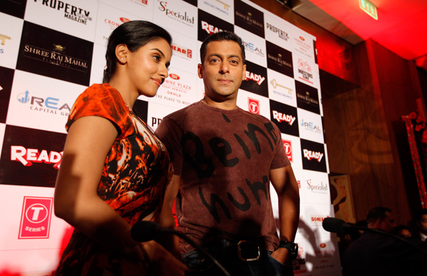 Bollywood actors Salman Khan, right, and Asin interact with the media ahead of the release of their new movie 'Ready' in New Delhi, India. (AP)