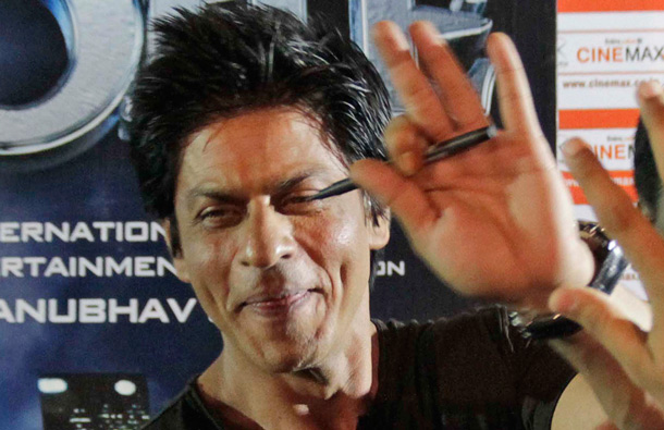 Bollywood actor Shah Rukh Khan waves to fans during a promotion of his upcoming film Ra.One, in Ahmadabad India. Ra.One is a Hindi science fiction superhero film. (AP)