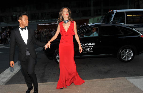 Designer Prabal Gurung, left, and model Alessandra Ambrosio arrive in a Lexus at the 2011 CFDA Fashion Awards in New York. (AP)