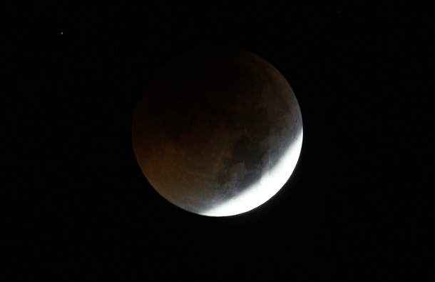 The Earth casts its shadow over the moon in a Total Lunar Eclipse. (AP)
