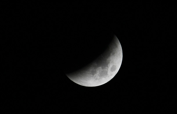 The Earth casts its shadow over the moon in a Total Lunar Eclipse as seen in Manila, Philippines before dawn Thursday June 16, 2011. The total lunar eclipse was visible in most parts of Asia. (AP)