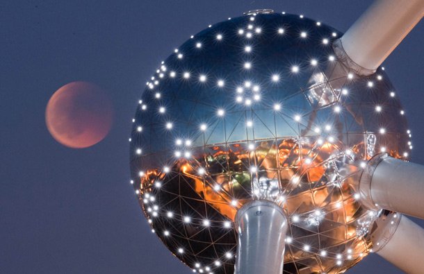 A lunar eclipse is seen over the Atomium in Brussels, early Thursday, June 16, 2011. (AP)