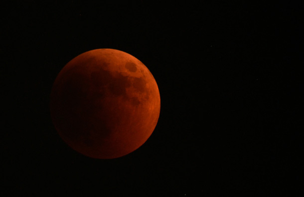 The moon turns red during a total lunar eclipse, as seen from Skopje, Macedonia. (AP)