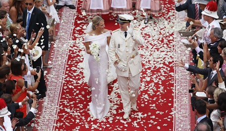 Princess Charlene of Monaco and Prince Albert Of Monaco smile as they leave the palace after the religious ceremony of the Royal Wedding of Prince Albert II of Monaco to Charlene Wittstock in the main courtyard at Prince's Palace on July 2, 2011 in Monaco, Monaco. The Roman-Catholic ceremony follows the civil wedding which was held in the Throne Room of the Prince's Palace of Monaco on July 1. With her marriage to the head of state of the Principality of Monaco, Charlene Wittstock will become Princess consort of Monaco and gain the title, Princess Charlene of Monaco. Celebrations including concerts and firework displays are being held across several days, attended by a guest list of global celebrities and heads of state.  (GETTY IMAGES)