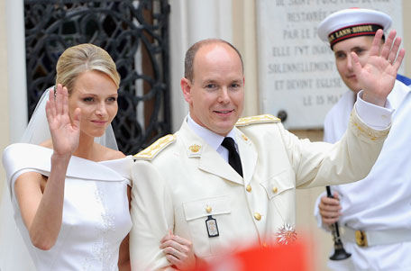 Princess Charlene of Monaco and Prince Albert II of Monaco wave to the crowd as they leave Sainte Devote church after their religious wedding ceremony at the Prince's Palace of Monaco on July 2, 2011 in Monaco. The Roman-Catholic ceremony followed the civil wedding which was held in the Throne Room of the Prince's Palace of Monaco on July 1. With her marriage to the head of state of the Principality of Monaco, Charlene Wittstock has become Princess consort of Monaco and gains the title, Princess Charlene of Monaco. Celebrations including concerts and firework displays are being held across several days, attended by a guest list of global celebrities and heads of state. (GETTY IMAGES)