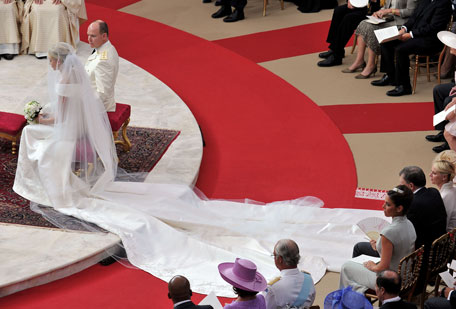 (L-R) Princess Charlene of Monaco and Prince Albert Of Monaco attend the religious ceremony of the Royal Wedding of Prince Albert II of Monaco to Charlene Wittstock in the main courtyard at Prince's Palace on July 2, 2011 in Monaco, Monaco. The Roman-Catholic ceremony follows the civil wedding which was held in the Throne Room of the Prince's Palace of Monaco on July 1. With her marriage to the head of state of the Principality of Monaco, Charlene Wittstock will become Princess consort of Monaco and gain the title, Princess Charlene of Monaco. Celebrations including concerts and firework displays are being held across several days, attended by a guest list of global celebrities and heads of state. (GETTY IMAGES)