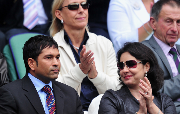 Indian cricketer Sachin Tendulkar (Front L) and his wife Anjali (Front R) are introduced to the Centre Court crowd on the sixth day of the 2011 Wimbledon Tennis Championships at the All England Tennis Club, in south-west London. (AFP)