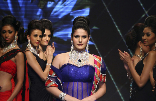 Indian Bollywood actress Zarine Khan poses on the catwalk during the second edition of The Indian International Jewellery Week (IIJW) 2011 in Mumbai. (AFP)