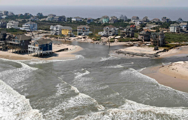 The road is washed out on the north end of  route 12 in the Rodanthe area on Hatteras Island, NC, Sunday, Aug 28, 2011.  Hurricane Irene swept through the area Saturday cutting the roadway in five locations. (AP)