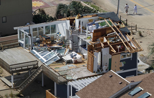 A house damaged by Hurricane Irene is seen in Virginia Beach, Va, Sunday, Aug 28, 2011.  From North Carolina to New Jersey, Hurricane Irene appeared to have fallen short of the doomsday predictions, but more than 4.5 million homes and businesses along the East Coast reportedly lost power, and at least 11 deaths were blamed on the storm. (AP)
