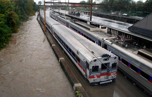 Two Southeastern Pennsylvania Transportation Authority trains sit in water on flooded tracks at Trenton train station Sunday, Aug 28, 2011, in Trenton, NJ, as rains from Hurricane Irene are causing inland flooding of rivers and streams. (AP)