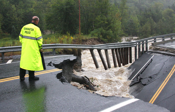 Bennington Police Chief Paul Doucette looks at a collapsed bridge on Route 9 in Woodford, Vt on Sunday, Aug 28, 2011. The remnants of Hurricane Irene dumped torrential rains on Vermont on Sunday, flooding rivers and closing roads from Massachusetts to the Canadian border, putting parts of two towns underwater and leaving one young woman swept away and feared drowned in the Deerfield River. (AP)