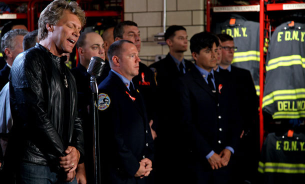 "Jon Bon Jovi performes a rendition of America The Beautiful at the NYFD Battalion 8, Engine 8, Ladder 2 fire house Wednesday, Sept 7, 2011 in New York to pay tribute to 9/11 first responders. The performance will air during a special ""NFL Kickoff 2011: Back to Football"" show on NBC Saturday night at 8 PM. (AP)"