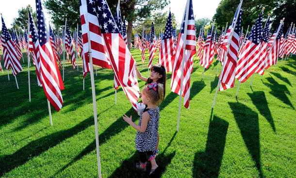 Tessa Clement, 6, (back) and her sister Terra Clement, 4, of Nevada walk through a field of of 2,996 American flags symbolizing the number of people killed in the terrorist attacks of September 11, 2001 at Palm Mortuary & Cemetery September 7, 2011 in Las Vegas, Nevada. The memorial will be displayed until September 18 for people marking the 10th anniversary of the 9/11 attacks.