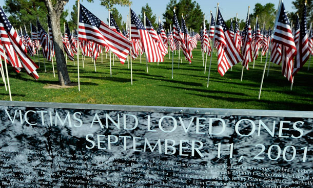 American flags are displayed behind a wall of remembrance listing the 2,996 names of those killed in the terrorist attacks of September 11, 2001, at Palm Mortuary & Cemetery September 7, 2011 in Las Vegas, Nevada. The memorial will be displayed until September 18 for people marking the 10th anniversary of the 9/11 attacks. (GETTY)