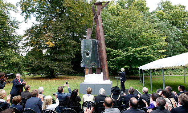 "London Mayor Boris Johnson, standing next to the sculpture, unveils the sculpture, designed by New York artist Miya Ando and made from steel recovered from the World Trade Center after the September 11, 2001 terrorist attacks, in Battersea Park in London, Monday, Sept 5, 2011. The artwork, called ""After 9/11"", was commissioned by the 9 11 London Project to mark the launch of its new education program. (AP)"