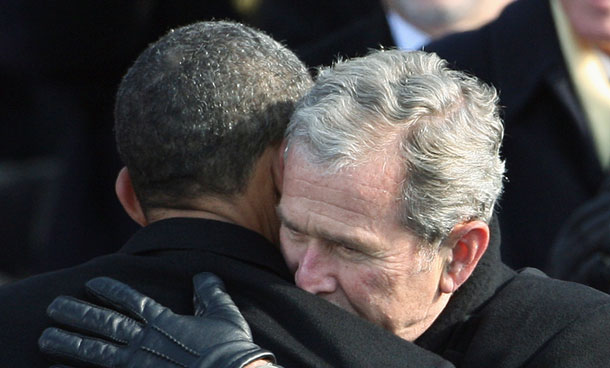 "In this Jan 20, 2009, file photo former President George W. Bush, right, hugs President Barack Obama after Obama was sworn in at the US Capitol in Washington. Handing off the wars and the swollen anti-terrorism apparatus to his successor, Bush said in his final White House address in 2009 that ""most Americans were able to return to life much as it had been before 9/11."" He quickly added: ""I never did."" (AP)"