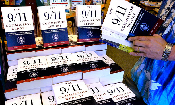 "A patron of the Barnes & Noble bookstore in Springfield, Ill, reads a copy of the ""The 9/11 Commission Report. (AP)"