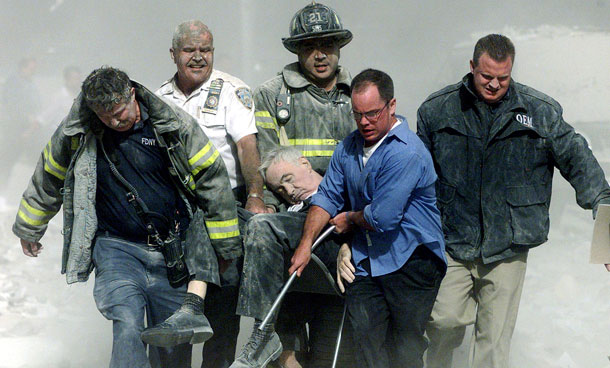 Police, firemen and a civilian carry the body of FDNY Chaplain Mychal Judge after he was killed in the collapse of the south tower at the World Trade Center in New York September 11, 2001 file photo. September 11th marks the 10th anniversary of the 9/11 attacks where nearly 3,000 people died when four hijacked airliners were used in coordinated strikes on the Pentagon and the World Trade Center towers. The fourth plane crashed in Pennsylvania. (REUTERS)