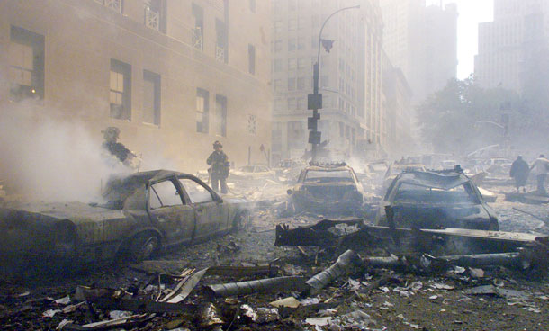Cars smolder in the street as the destroyed World Trade Center burns in New York in this September 11, 2001 file photo. September 11th marks the 10th anniversary of the 9/11 attacks where nearly 3,000 people died when four hijacked airliners were used in coordinated strikes on the Pentagon and the World Trade Center towers. The fourth plane crashed in Pennsylvania. (REUTERS)