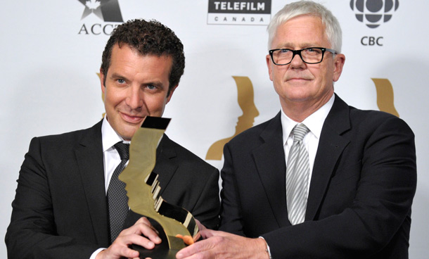 """Rick Mercer and producer Gerald Lunz (R) hold their award for best comedy program or series for """"Rick Mercer Report"""" at the 26th Gemini Awards in Toronto September 7, 2011. (REUTERS)"""