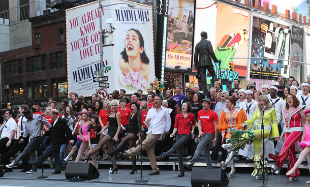 "Broadway performers sing ""New York, New York"" to commemorate the 10th anniversary of the Sept 11 attacks, Friday Sept 9, 2011 in New York's Duffy Square. The mini-concert was a replay of what the Broadway community sang 10 years ago to promote theater in New York City following 9/11. (AP)"