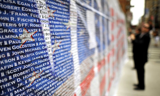 A visitor reads the names and of 9/11 terrorist attack victims on a wall outside Ground Zero memorial  in Manhattan on September 10, 2011. New York marks the 10th anniversary of the 9/11 terrorist attacks on Sunday. (AFP)