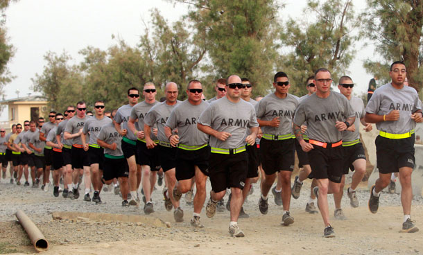 US soldiers from Task Force Bronco take part in a memorial run to commemorate the 10th anniversary of the 9/11 attacks, at FOB Shinwar, a US military camp in Nangarhar, Afghanistan September 11, 2011. (REUTERS)