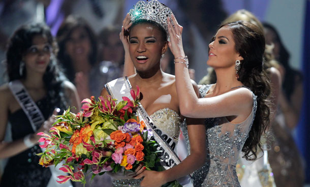 Miss Angola Leila Lopes, left, is crowned Miss Universe 2011 by Miss Universe 2010 Ximena Navarrete, of Mexico, in Sao Paulo, Brazil, Monday Sept 12, 2011. (AP)
